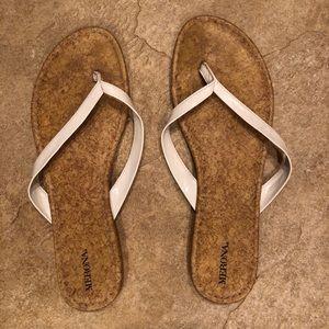 Classic white flip flops with cork bottom
